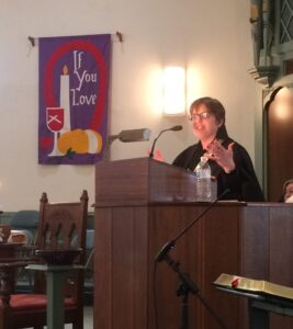 Pastor McColl preaching from the pulpit